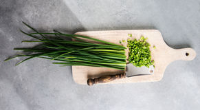 Chopped chives on cutting board Stock Image