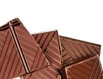 Chopped chocolate bar isolated on white background. Dark chocola Stock Photos