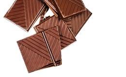 Chopped chocolate bar isolated on white background. Dark chocola Stock Photography