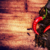 Chopped Chocolate Bar with Red Chilli Pepper on wooden backgroun Royalty Free Stock Photo