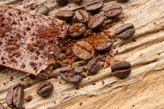 Chopped chocolate and coffee bean with cocoa on wood Stock Photography