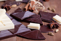 Chopped chocolate and spices Stock Images