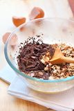 Chopped chocolate and walnuts in glass bowl Stock Photo