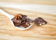 Chopped chocolate on the wooden spoon Royalty Free Stock Photos