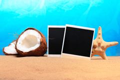 Chopped coconut and photoframe on the sand Royalty Free Stock Photos