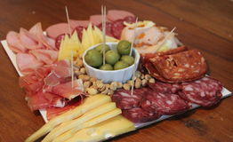 Chopped cold cuts. Chopped table of cold cuts with beer Stock Photography