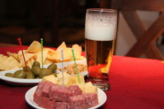 Chopped cold cuts. Chopped table of cold cuts with beer Royalty Free Stock Photo