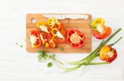 Chopped colorful sweet peppers and green onions on white Stock Photos