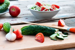 Chopped cucumber and tomato salad on a cutting board Royalty Free Stock Photography