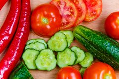 Chopped cucumber and tomatoes, red pepper flat lay stock photo