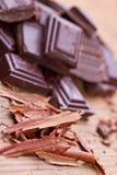 Chopped dark chocolate with cocoa. Closeup Chopped dark chocolate with cocoa Stock Image
