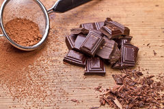 Chopped dark chocolate with cocoa. Closeup Chopped dark chocolate with cocoa Royalty Free Stock Images