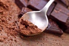 Chopped dark chocolate with cocoa. Closeup Chopped dark chocolate with cocoa Royalty Free Stock Photography