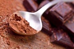 Chopped dark chocolate with cocoa. Closeup Chopped dark chocolate with cocoa royalty free stock photos