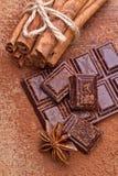 Chopped dark chocolate with cocoa Stock Photos
