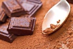 Chopped dark chocolate with cocoa. Closeup Chopped dark chocolate with cocoa Stock Photography