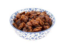 Chopped dates in a blue and white china bowl Royalty Free Stock Photography