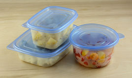 Chopped dinner ingredients of cauliflower, potatoes and cherry tomatoes. In plastic refrigerator storage containers prepared in advance for quicker cooking Stock Image