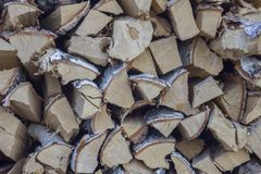 Chopped dry gray birch firewood close-up lie in a heap in rows. natural surface texture. A chopped dry gray birch firewood close-up lie in a heap in rows stock images