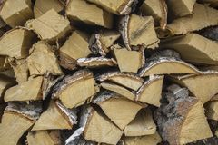 Chopped dry yellow birch firewood close-up lie in a heap in rows. natural surface texture. A chopped dry yellow birch firewood close-up lie in a heap in rows stock image