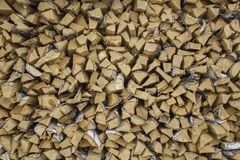 Chopped dry yellow birch firewood lies in a heap in rows. natural surface texture. A chopped dry yellow birch firewood lies in a heap in rows. natural surface stock photo