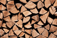 Chopped fire wood. Stacked chopped fire wood texture background Stock Image