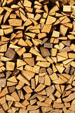 Chopped fire wood. Background of dry chopped spruce firewood logs in a pile - a natural vertical background Royalty Free Stock Image
