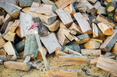 Chopped fire wood in a pile with an axe Stock Photo