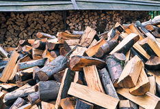 Chopped firewood logs in pile. Nature background. Wood preparation. Large pile of fresh cut wood Royalty Free Stock Image
