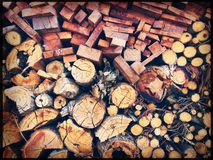 Chopped firewood logs stacked in a wall Royalty Free Stock Photos