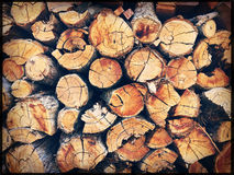 Chopped firewood logs stacked in a wall Stock Photography