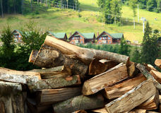 Chopped firewood over cottages at mountain hill stock photo Royalty Free Stock Photos
