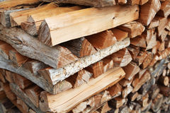 Chopped firewood. Rows of chopped firewood arranged in a stack Stock Image