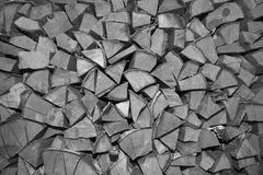 Chopped firewood stacked. Black and white Royalty Free Stock Photography