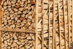 Chopped firewood stacked in boxes Royalty Free Stock Images