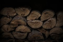 Chopped firewood stacked in a fireplace. Selective focus. Toned Royalty Free Stock Photo