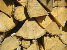 Chopped firewoods. The chopped firewoods are built in the stack of wood. texture royalty free stock image