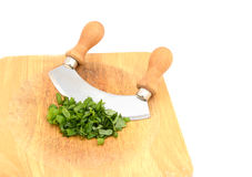 Chopped fresh basil leaves with a rocking knife Royalty Free Stock Photography