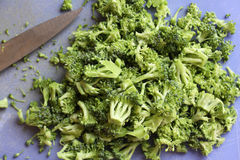 Chopped fresh broccoli. On a board with shallow dof Royalty Free Stock Photography