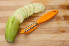 Chopped fresh cucumber with a tool for peeling Royalty Free Stock Images
