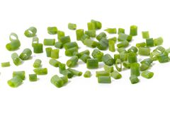 Chopped fresh green onions isolated on white background.  stock images