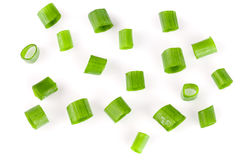 Chopped fresh green onions isolated on white background. Top view. Chopped fresh spring onions isolated on white background. Top view stock photos