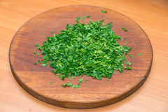 Chopped fresh herbs, wooden board. Step by  cooking. Chopped fresh herbs, wooden board. Step by step cooking Stock Photography