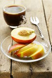 Chopped fresh peach with a cup of coffee Royalty Free Stock Image