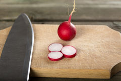 Chopped Fresh Radishes. With A Knife On A Wooden Board Royalty Free Stock Photo