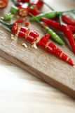 Chopped fresh red  chilli on wooden chopping block. Royalty Free Stock Photography