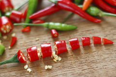 Chopped fresh red and green chilli on wooden chopping block. Stock Photography