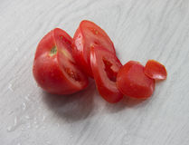Chopped fresh tomato. Chopped fresh tomato on wood background Royalty Free Stock Photography