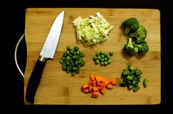 Chopped fresh vegetables arranged on cutting board stock photos