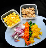 Chopped fresh vegetables on black background Royalty Free Stock Photography